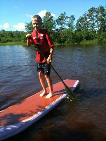 Kid on a diy paddle board.