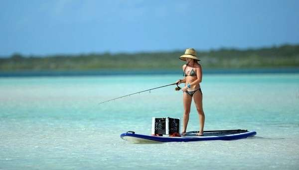 Woman SUP fishing.